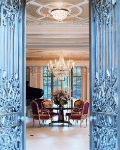 Custom decorative bronze doors that leads into a spacious reception hall.