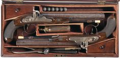 Cased Pair of Engraved Henry Nock Percussion Pistols with Accessories -A) Engraved Henry Nock Percussion Pistol