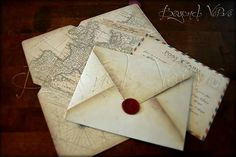 Postcard wedding invitation with old maps and sealing wax stamp - Travel themed wedding - Vintage wedding stationery - Beyond Verve
