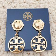 Tory Burch circle logo drop earrings Ionic tory burch logo dangles from a geometric stud, creating gleaming modern earrings. 1 1/4 drop, 3/4 width. Post back. 16 k gold. Brand new with dust bag! Tory Burch Jewelry Earrings