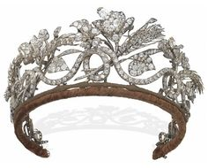 AN ANTIQUE DIAMOND TIARA.   Designed as a continuous scrolling old-cut diamond line with wheat sheaves, flowers, leaves and buds all interwoven, mid-19th Century, inner circumference 38.0 cm, in navy blue velvet fitted E. Böhm Vienna case