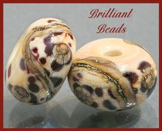 Snow Leopards...Ivory and Brown Glass Bead Pair  by Gillianbeads