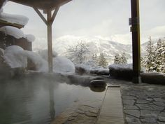 Outdoor hot springs bath (rotemburo) at Hakuba Highland Hotel (Nagano, Japan)
