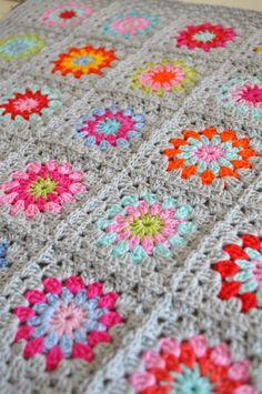grey bordered granny blanket