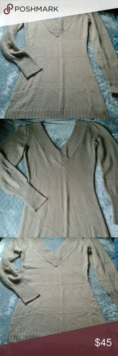 Womem's tan V neck Guess sweater dress L Like new worn once women's tan long sleeve Guess sweater dress size Large. Deep V neck with pleated shoulders. This dress is hot!!! Please see pictures for more details. Thanks for looking!! This could be worn as a long shirt or a dress!! Guess Dresses Long Sleeve