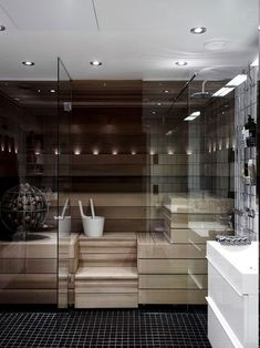 ▷ 1001 + ideas for designer bathrooms - your dream will come true!Sauna with LED light, rainbow shower, small black floor tiles, three metal cosmetic shelves, small LED lamps on the ceilingA nice sauna: a Minimal Bathroom, Modern Bathroom, Boho Bathroom, Small Bathroom, Sauna Heater, Sauna Design, Sauna Room, Dream Bathrooms, Marble Bathrooms