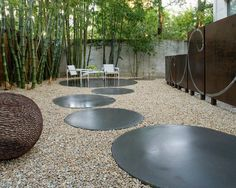 modern landscape and traditional asian elements bamboo trees stone paths