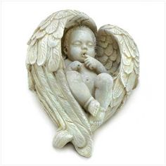 An angelic infant snuggles beneath the shelter of his furled feathered wings, dreaming sweet and loving dreams.