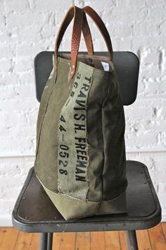Sturdy, worn-in canvas salvaged from a WWII era US military duffel bag has been turned into a perfect everyday tote bag. The material used to construct this bag
