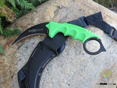 United Cutlery M48 Apocalypse Karambit Fixed 4.0 Inch Black Blade 2951. Face the zombie apocalypse head on with the latest United® M48 Apocalypse Kerambit! Featuring a solid, thick, wicked-sharp curved blade, this karambit is crafted of black-coated 7CR13 stainless steel and completed by a bright green rubberized handle. http://www.osograndeknives.com/catalog/fixed-blade-karambits/united-cutlery-m48-apocalypse-karambit-fixed-4.0-inch-black-blade-2951-24854.html