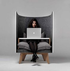 The V1 Chair is the ultimate in contemporary multifunctional seating. The chair consists of a simple cushioned bench made from a wooden frame, encompassed by a head-height semicircular backing that cocoons those seated within for complete privacy. http://vurni.com/v1-lounge-chair-desk/