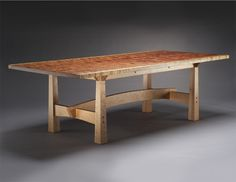 The base of this grand dining table is constructed with solid cherry and ebony accents. The top of the piece shown consists of two unique, book matched bubinga slabs. Other top wood possibilities migh