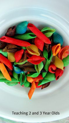 We dyed pasta the colors of the rainbow and used it as collage material. Great for toddlers and preschoolers!