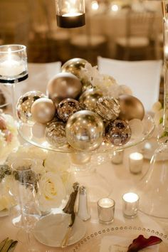 Winter centerpiece.  Cake stand plus Christmas ornaments equals beautiful decoration.