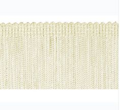 """Our 100% Rayon Fringe can be used for sewing or crafts, costumes, lampshades, draperies, and other home decor items Available in 2"""", 3"""", and 4"""" Color: Off-White"""