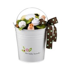cute baby shower gift. the white roses are baby clothes