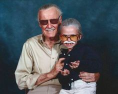 Little girl cosplaying as Stan Lee sitting on Stan Lee's lap. This is FANTASTIC.
