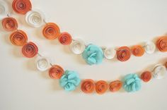 Hey, I found this really awesome Etsy listing at https://www.etsy.com/listing/129488360/garland-paper-flowers-orange-teal-white