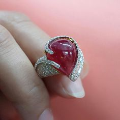 @petchchompoojewelry.  Stunning 15 carats pear shape African ruby surrounded by 1.50 carats white diamonds.