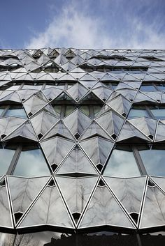 Origami office building, Paris, France. Principal Architect: Manuelle Gautrand, Completed 2011. Folded marble can be seen exterior and interior.