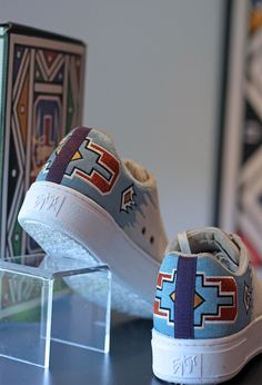 'Gogo' is considered an art pioneer. She has exhibited around the world and painted everything from houses, cars, shoes and even skateboard decks. Mash T Shirt, African Accessories, Native Shoes, Music Gifts, Skateboard Decks, Stylish Jewelry, Painted Shoes, Nature Paintings, Custom Shoes