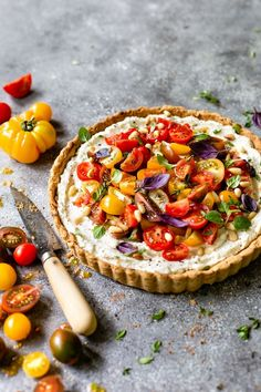 Tomato Ricotta Tart Recipe: Buttery crust filled with ricotta mixture and topped off with juicy heirloom tomatoes. #tomatoes #tomatotart