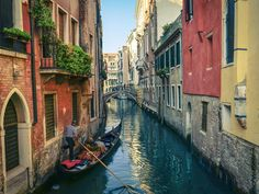 Take a gondola ride through the magnificant canals in Venice.
