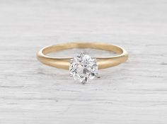 Edwardian vintage Tiffany & Co. engagement ring made in 18k yellow gold with a .68 carat old European cut diamond circa 1910