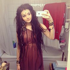 Messy dreadies, exotic jewelry, clean style. love it, love it.