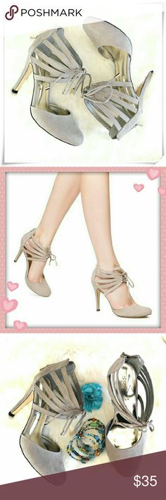 "Terilyn heels. Comfy ladylike pumps with cutout details, and a delicate lace up add interest to the classic look. Taupe color, adjustable laces.  Details: heel 4"", fits TTS, comfy.  Please use only ✔OFFER 👈🔴 button for all price negotiations. I'll do 👉🍓a price drop⤵ for you for discounted shipping, if we agree about the price. JustFab Shoes Heels"