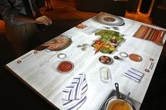 Interactive projected table at Our Global Kitchen at the American Museum of Natural History, New York