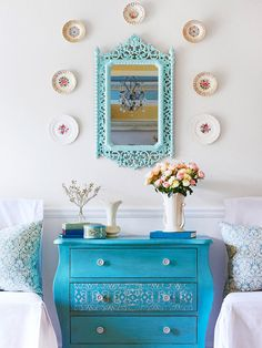 Old patterned plates are a gorgeous (and inexpensive) way to add a personal touch to your walls! More house tour photos here: http://www.bhg.com/decorating/decorating-style/cottage/blue-cottage/?socsrc=bhgpin061814treasurechestpage=4