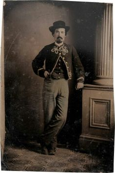 """Carte de VisiteSize Tintype of a Union Soldier in a Zouave Style Uniform.2.75"""" x 4"""". The soldier is posed standing wearing an ornately trimmed Zouave-style shell jacket. Very good."""