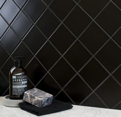 Inject a dark, suave look into your wall spaces with these Spellbound Matt Black Tiles. Made from porcelain, they're perfect for a bathroom or kitchen.