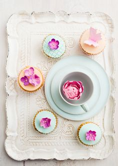"""Some people think that """"vanilla"""" is synonymous with """"boring,"""" but National Vanilla Cupcake Day is dedicated to dispelling that myth. The very first cupcakes date back to the late 18th century and took their name from the small ramekins or cups in which they were baked. (Who knew nonstick muffin tins weren't widely available in the 1700s?) We've come a long way since then—now, cupcakes are miniature, edible works of art that are almost too pretty to eat. #vanillacupcakes #fandbrecipes #cupcakes A Food, Good Food, Cupcake Day, B Recipe, Muffin Tins, Vanilla Cupcakes, 18th Century, Beverage, Health And Wellness"""