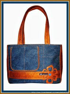 The orange color just pops on this denim bag