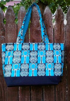 b2e83fe866e Items similar to Large Turquoise Quilted Tote with African Symbols on Etsy