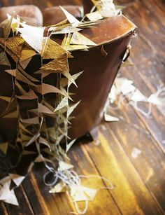 """A Garland.  Looks as if each """"flag"""" has a message written on it.  Paper looks like parchment?  See the second post also."""