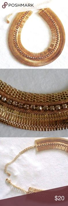 Ali-Kahn New York Big Gold & Rhinestone Necklace 5 layers of different texture links with a single row of sparkling white rhinestones.  22 inches, adjustable to shorter length.  Approx 1.4 inches wide. Heavy,  well made,  signed Ali-Kahn New York . Excellent used condition.  Goes beautifully with the black velvet formal in my closet. Ali-Kahn New York Jewelry Necklaces