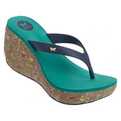0af15de9e9 This wedge sandal has a colour-splattered cork detailing effect on the sole  and is finished with a Zaxy metallic butterfly pin.