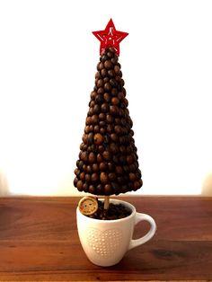 Alberello con chicchi di caffè