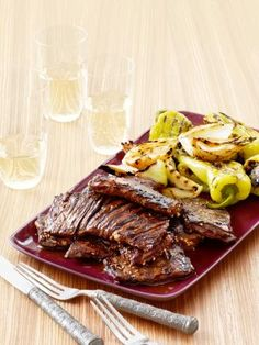 Grilled Korean-Style Skirt Steak : Marinating the skirt steak overnight in a sweet and savory combo of sesame, garlic, cola and soy sauce packs it full of flavor. Grill it simply with onions and peppers for one easy, tasty dish.