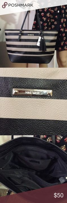 👠NINE WEST TOTE💋NWT This bag is great to used in place of your leather bags that are not easy to clean. Great for travel, going to the zoo, beach, pool bag or even as a diaper bag! Black and grey (non-leather) Tote with zipper closure. This bag features three separate compartments that is divided by a zip closure.  On one side, THIER is a 2 open slide pockets for phone, and other phone shaped valuables.  Other side of bag has one medium size zip pocket closure.  Bag zips closed.  Tassel on…