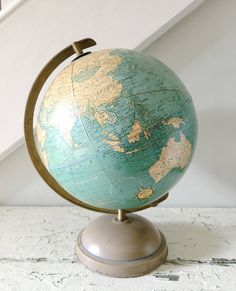 charming vintage 12 inch world globe... Universal Terrestrial Globe by George F. Cram Co. beautifully aged with perfect patina. the tape is missing and there are imperfections from use and age. (please see photos) I love them this way... the metal stand is strong and sturdy, and the globe rotates smoothly. great collectors item, or fun vintage decor for your home or office. love this one.  measures approximately 18 h