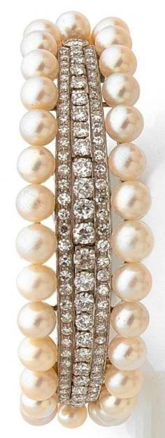 An ArtDeco cultured pearl, diamond, platinum and gold bangle, circa 1935. Set…