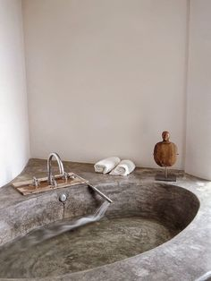 Bathroom with concrete bathtub.