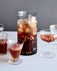 Pomelder Prosecco Punch - This sweet-tart, aromatic punch gets a ton of flavor and a rosy hue from pomegranate juice that's reduced to a syrup with fresh ginger and cardamom. St. Germain elderflower liqueur adds fragrant sweetness. http://www.foodandwine.com/recipes/pomelder-prosecco-punch?xid=DAILY012315PomelderProseccoPunch