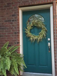 Decorated for summer/spring - Teal painted front door with red bricks -- I've posted my painted front door before, but it had a fall wreath. Here it is updated for spring and summer. The color is Behr Ultra Verdant Forest - purchased at Home Depot, exterior flat.