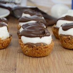 S'more Bites. Made with graham crackers, powdered sugar, butter, milk chocolate, and marshmallows.
