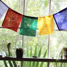 For centuries upon centuries, Tibetan Buddhists have hung these flags outside their homes and places of spiritual practice for the wind to carry the ancient Bud